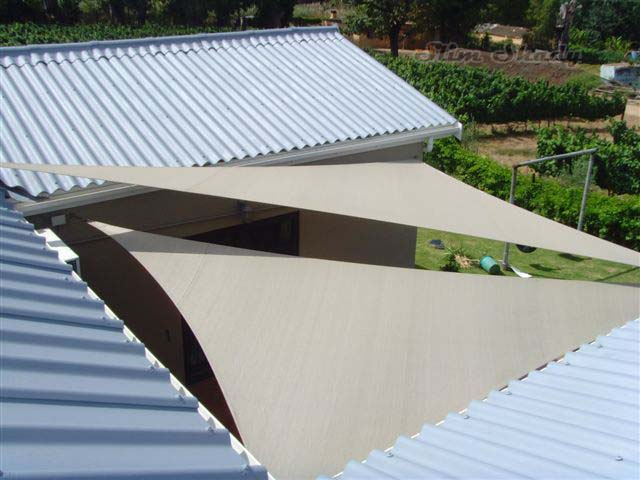 Courtyard triangular shade sails